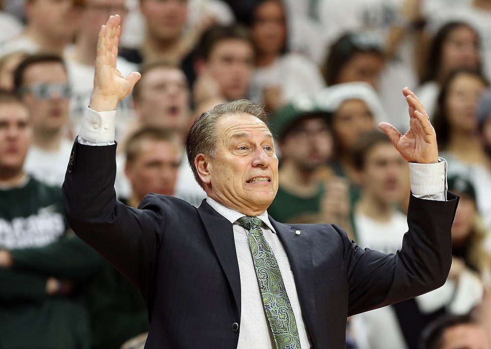 Michigan State players restrain Tom Izzo after heated exchange with Henry